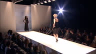 WS PAN Series of male and female models walking on catwalk in front of audience at fashion show/ London, England
