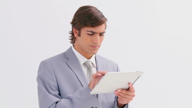 Serious businessman using an ebook