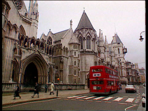 Nadir / Mates issue ITN ENGLAND London GV High Court as traffic past LA More ditto LMS Entrance ditto