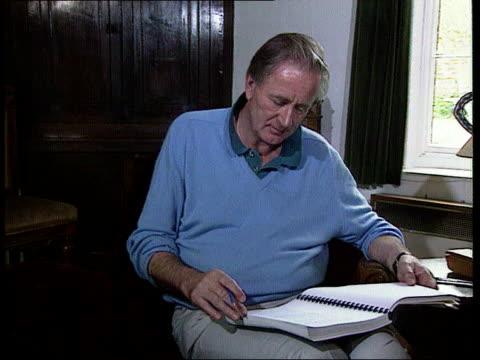 Nadir / Mates issue ITN Bucks Haddenham CMS Scrivener sitting working at desk TCMS His hands as underlining text in book