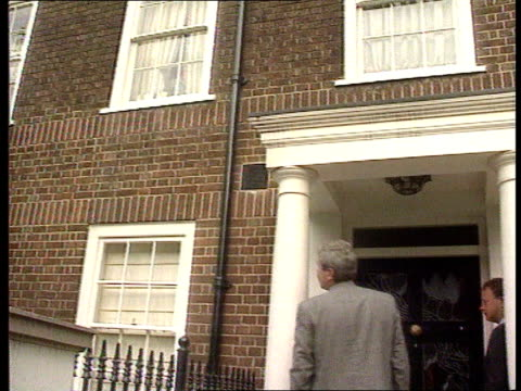 Nadir / Mates issue ITN Chelsea BV Police standing at front door of Kevin Maxwells house TILT UP to wife shouting out of window at them BV Police by...