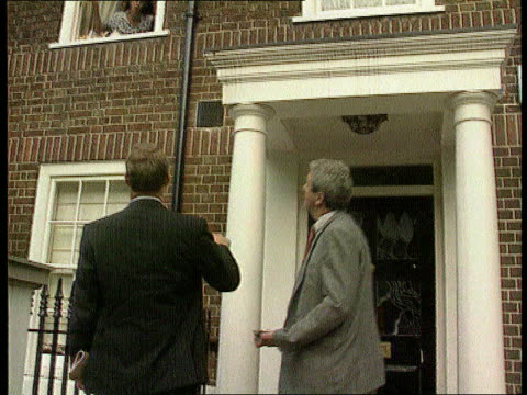 Nadir / Mates issue London Chelsea BV Police at front door of Kevin Maxwell as his wife talks to them from upper window SOF BV More ditto as she says...