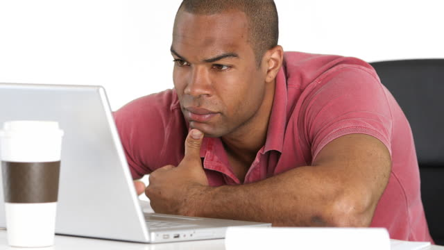Serious man with laptop working