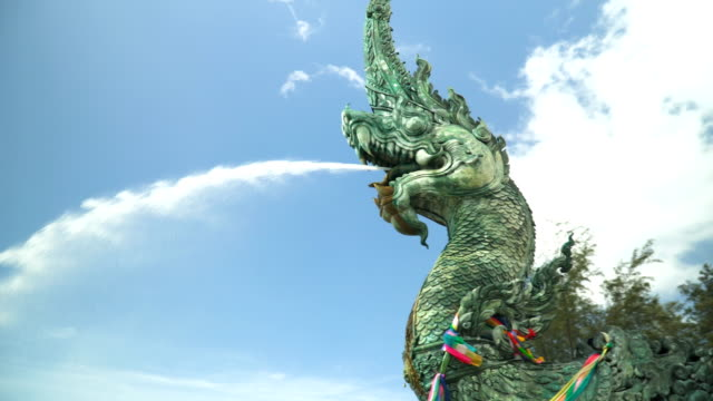 serpent king statue with beautiful sky