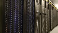 Servers stand in a computer room at the Yahoo Inc Lockport Data Center in Lockport New York US Shots pan across a row of servers in a server room at...