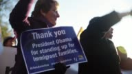 Service Employees International Union International President Mary Kay Henry holds a sign as she participates in the rally to celebrate the president...