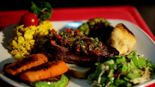 Serving of grilled beef steak with vegetables
