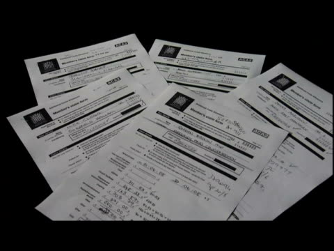Set up shots showing various documents relating to MP's expense claims