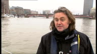 Reporter to camera in boat Port of London Authority boat up River Thames Reporter and Roger Bowdler looking at bridges from boat Houses of Parliament...
