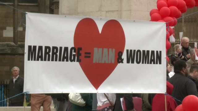 Several dozen people gathered outside the Houses of Parliament in London to protest against government plans to legalise gay marriage CLEAN...