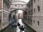 Several gondolas in a canal - Venice