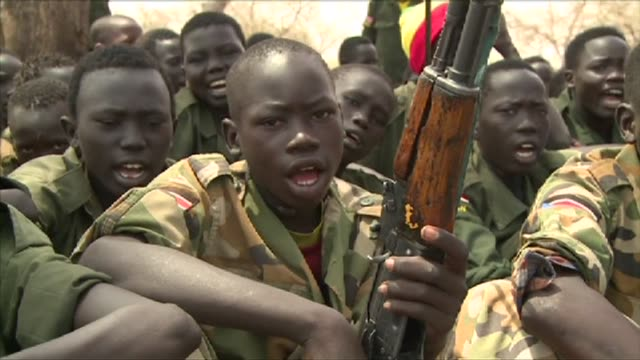 Several hundred children from an armed group in South Sudan surrendered on Tuesday their weapons and uniforms in a ceremony overseen by the South...