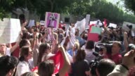 Several hundred demonstrators gathered outside a court in Tunis early on Tuesday waving banners and placards and shouting slogans in support of a...