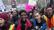 """Several hundred high school students walked out of school to protest and denounce President Donald Trump's policies / Student chanted """"No Ban No..."""