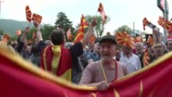 Several hundred Macedonians protest after an eruption of violence in the unstable Balkan country's parliament which left about 100 people injured