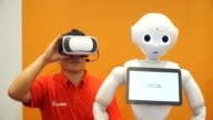 Several SoftBank Group Corp's Pepper the humanoid robots stand during a press preview ahead of the Pepper World 2016 Summer event in Tokyo Japan on...
