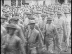 Several soldiers assemble near tents in open field / Lieutenant General Ben Lear confers with uniformed officers and inspects assembled troops / a...