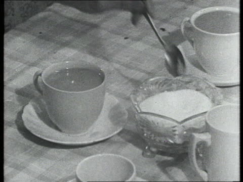 Several spoonfuls of sugar are added to a cup of tea