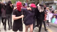 Several streets in Melbourne's central business district were shut down Sunday as antiracism and antiimmigration groups held rival rallies in...