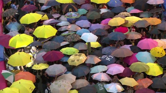 Several thousand protesters unfurl their umbrellas to mark the one month anniversary