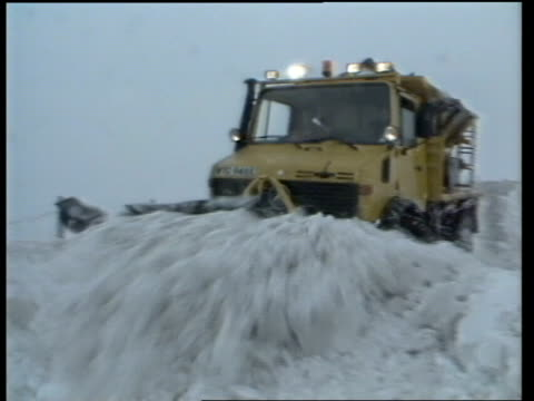 Severe weather hits north of England ENGLAND YorkshireRoad between Oldham and Halifax EXT Snow plough pushing snow from road TOWARDS Plough TOWARDS...