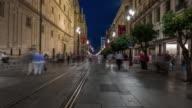 Sevilla giralda cathedral timelapse at night with many people walking corpuscristi