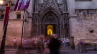 Sevilla giralda cathedral timelapse at night with people at entrance corpuschriti