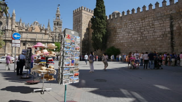 Seville postcards moorish wall and tourists