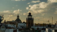 seville rooftop view timelapse with clouds and old buildings