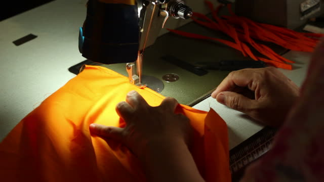 Sewing yellow costume.