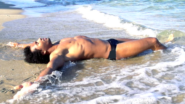 HD SUPER SLOW MO: Sexy Man Lying On The Beach