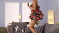 Sexy woman dancing in floral dress