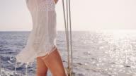 SLO MO Sexy woman enjoying the wind on a sailboat