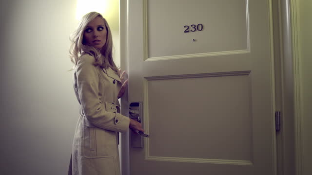 Sexy woman opens door