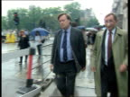 Shadow cabinet resignation over single currency ITN London Westminster Raining Kenneth Clarke MP and David Curry MP along and down steps of underpass...