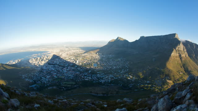 Shadow Cast Across City As Night Falls And Lights Turn On Over Cape Town Sout