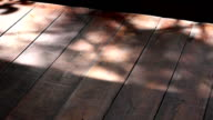 Shadow leaves on a wooden board.