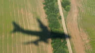 Shadow of the airplane moving down