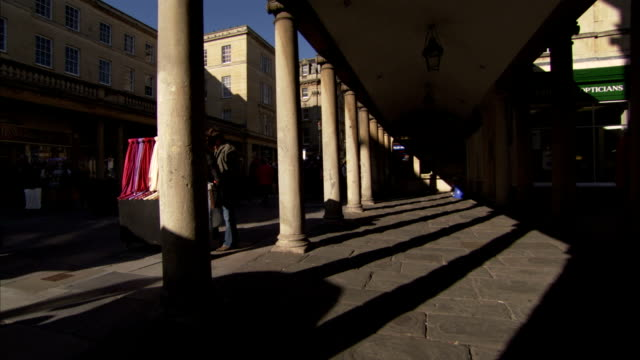 Shadows cast by pillars of Georgian shopping arcade in Bath. Available in HD.