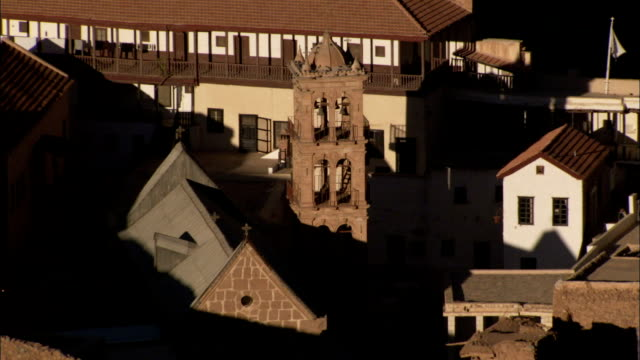 Shadows cover roofs of buildings at Saint Catherine's Monastery in Egypt. Available in HD.