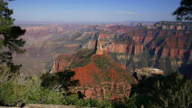 TIME LAPSE LONG WIDE SHOT shadows move over North Rim of Grand Canyon at sunset