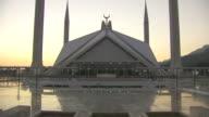 Shah Faisal Masjid w/ east entrance courtyard FG *SOT Call to Prayer over loudspeaker Sacred Destination religion religious South Asia capital city...
