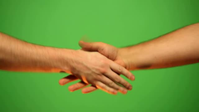 HD: shaking hands of friends