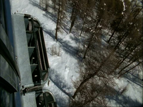 WA shaky POV cable car, view to snow covered ground below, Alps, Switzerland