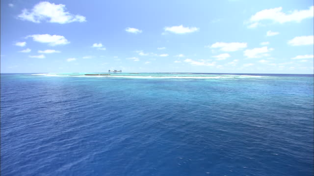 Shallow seawater surrounds protected Kita-Kojima islets near a research platform,Okinotorishima.