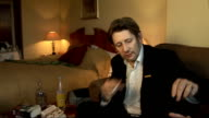 Shane MacGowan interview and general views ENGLAND London INT Shane MacGowan sitting in hotel room smoking chatting indistinctly to TV crew shuffling...