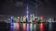 Shanghai skyline and Huangpu river,with lightshow on shanghai tower