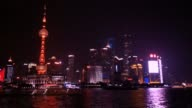 Shanghai time lapse from the Bund with the colorful boats.