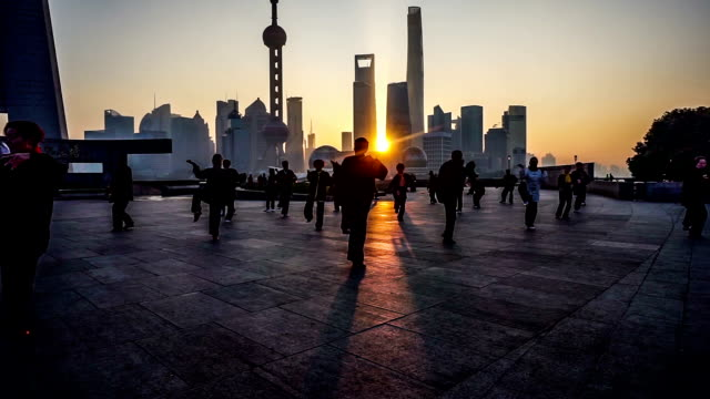 Shanghai,China-Nov 28,2015: In the early morning,people do Taijiquan at the bund, Shanghai, China