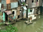 Shanty houses on the banks of the swollen Pasig river, Manila, Philippines, Typhoon Mirinae 2009